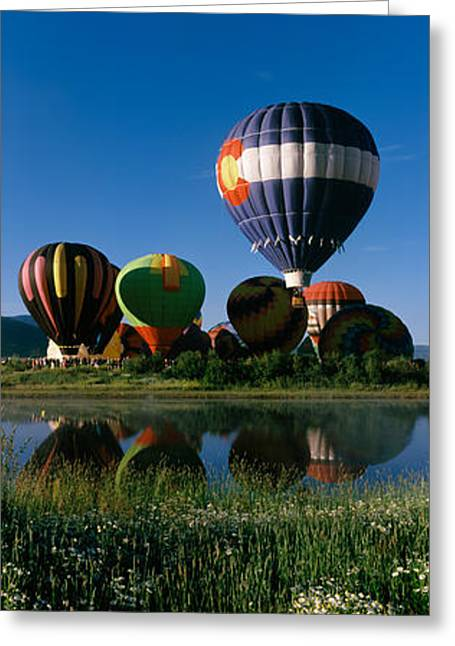 Reflection Of Hot Air Balloons Greeting Card by Panoramic Images