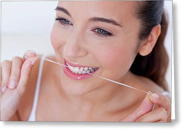 Woman Flossing Teeth Greeting Card by Ian Hooton