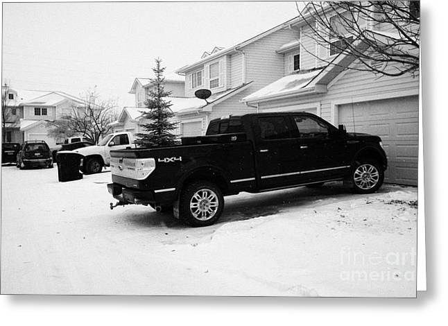 4x4 Pickup Trucks Parked In Driveway In Snow Covered Residential Street During Winter Saskatoon Sask Greeting Card