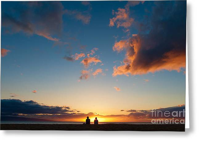 Couple Watching The Sunset On A Beach In Maui Hawaii Usa Greeting Card