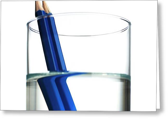 Refraction In A Glass Of Water Greeting Card by Science Photo Library