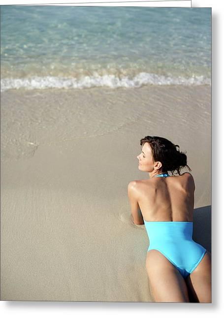 Woman Sunbathing Greeting Card
