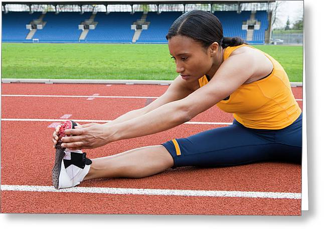 Athlete Stretching Greeting Card by Gustoimages/science Photo Library