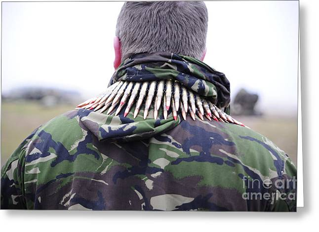 7.62mm Rounds Around The Shoulders Greeting Card by Andrew Chittock