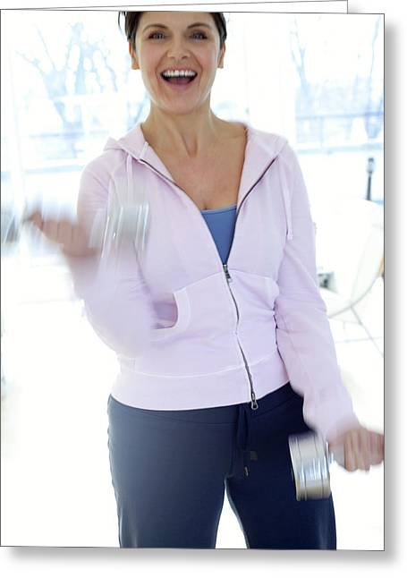 Woman Exercising Greeting Card by Ian Hooton/science Photo Library
