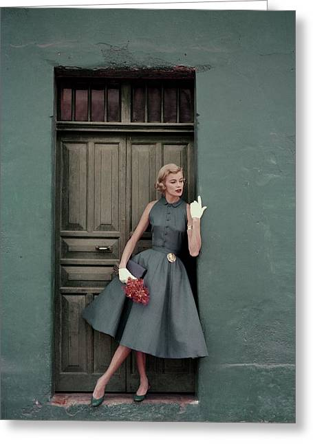 A 1950s Model Standing In A Doorway Greeting Card by  Leombruno-Bodi