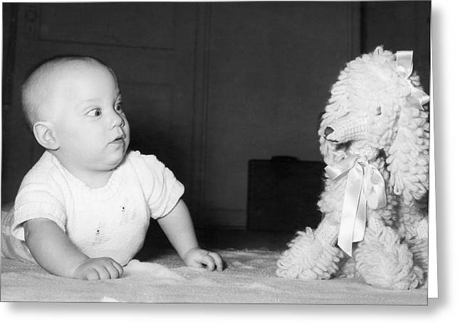 A Baby And A Toy Dog Greeting Card by Orville Andrews