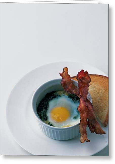 A Baked Egg With Spinach Greeting Card by Romulo Yanes