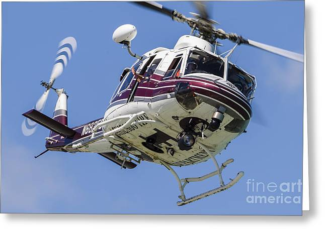 A Bell 412 Helicopter Flies Greeting Card