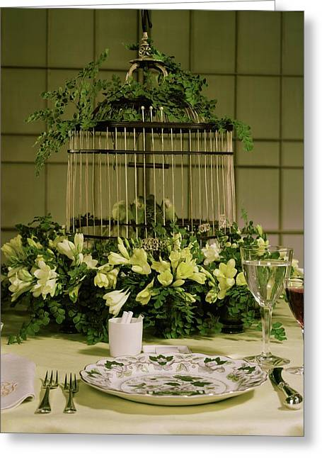 A Birdcage In The Middle Of A Table Greeting Card by Wiliam Grigsby