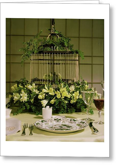 A Birdcage In The Middle Of A Table Greeting Card