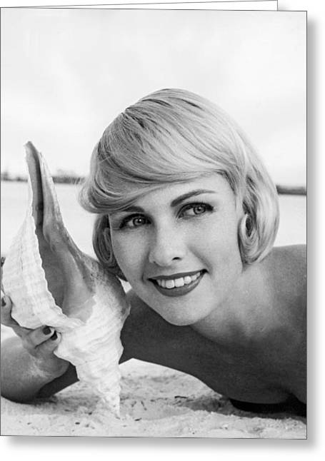 A Blonde And A Shell Greeting Card by Underwood Archives