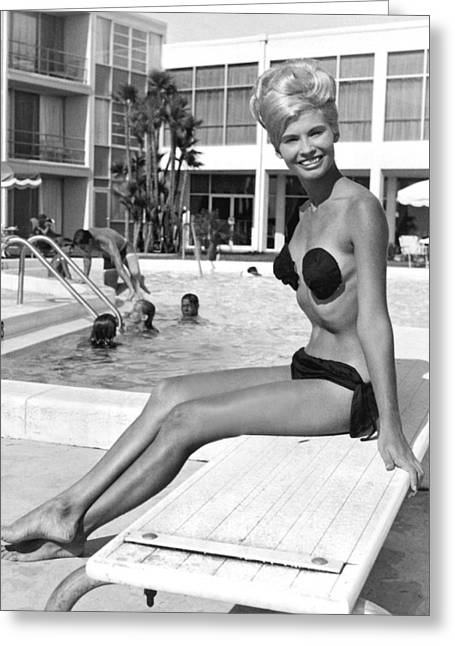 A Blonde Wearing A Tri Kini Greeting Card by Underwood Archives