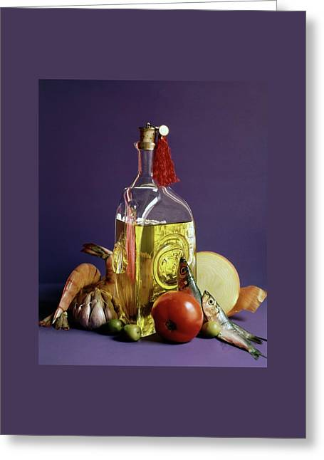 A Bottle Of Olive Oil Surrounded By A Variety Greeting Card by Fotiades