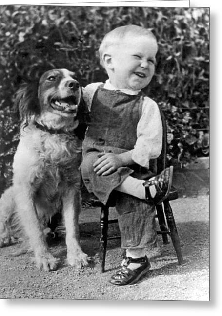 A Boy Laughs With His Dog Greeting Card by Underwood Archives