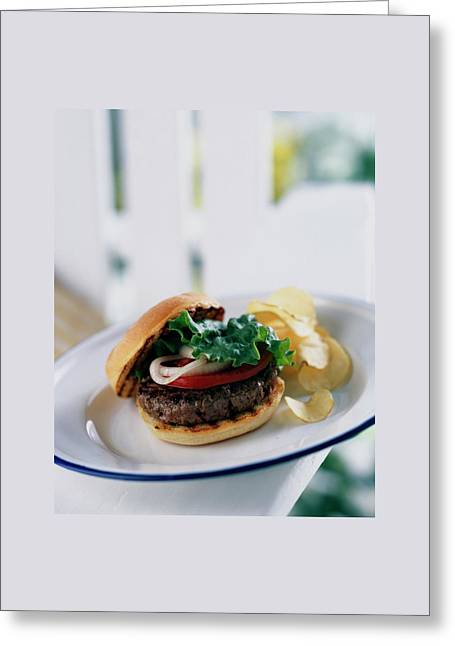 A Burger With Potato Chips Greeting Card by Romulo Yanes