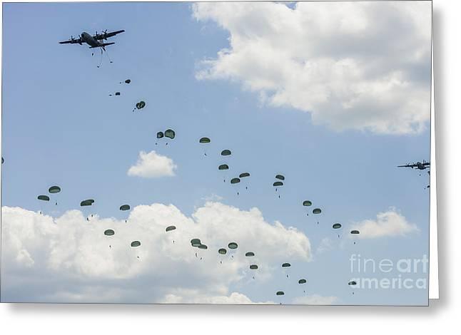 A C-130 Hercules Drop U.s. Army Greeting Card by Rob Edgcumbe