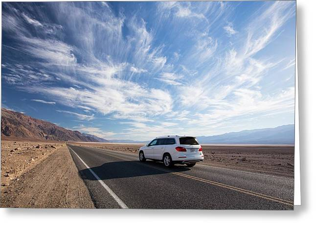 A Car On The Road Near Badwater Greeting Card