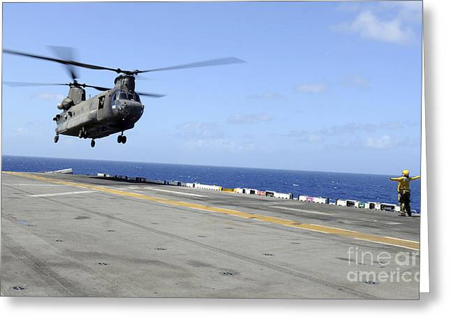 A Ch-47 Chinook Helicopter Landing Greeting Card by Stocktrek Images