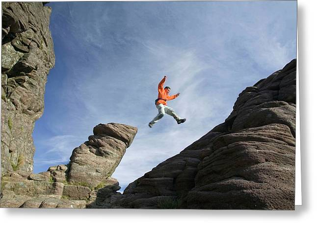 A Climber On Stac Pollaidh Greeting Card by Ashley Cooper