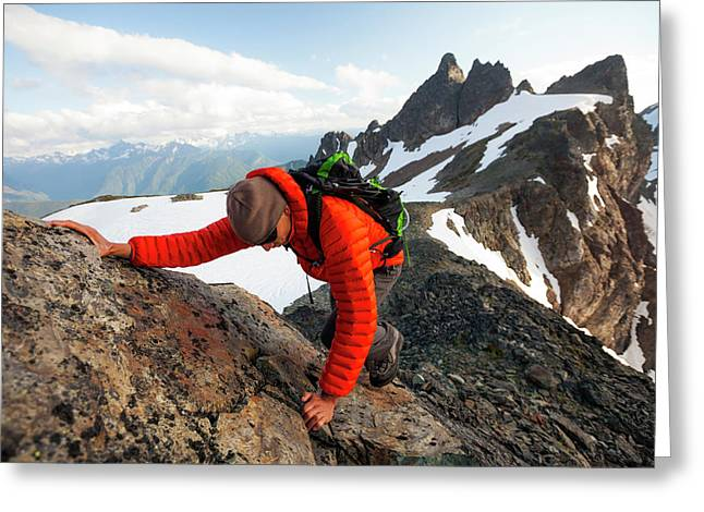 A Climber Scrambles Up A Rocky Mountain Greeting Card