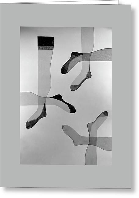 A Collage Of Stockings Greeting Card by Herbert Matter
