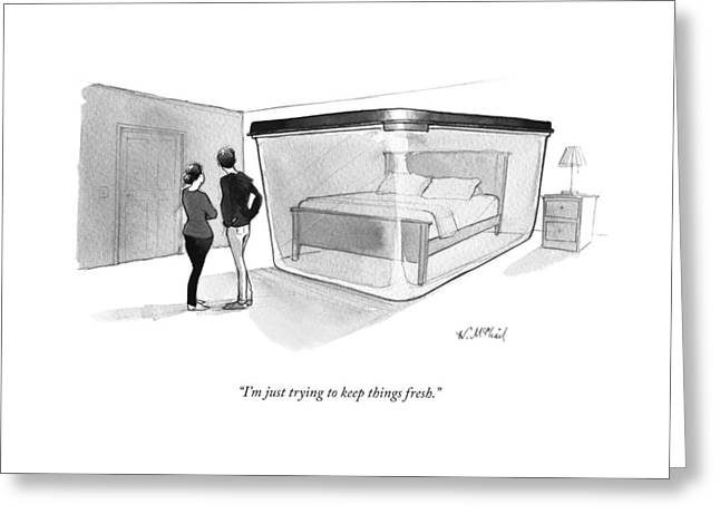 A Couple Looks At A Bed Encased In A Giant Greeting Card