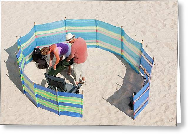 A Couple Setting Up Camp Greeting Card by Ashley Cooper