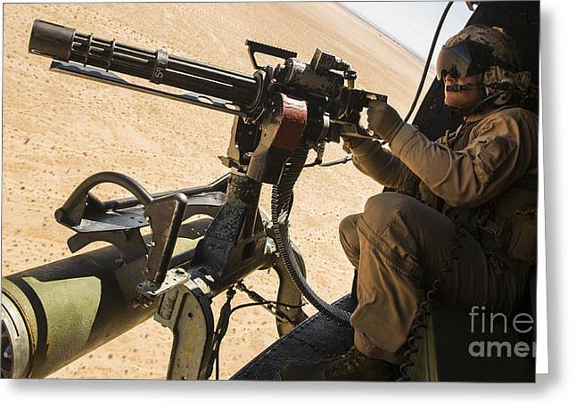 A Crew Chief Mounts A M134 Minigun Greeting Card by Stocktrek Images
