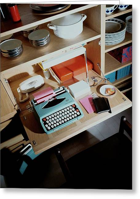 A Cupboard With A Blue Typewriter Greeting Card