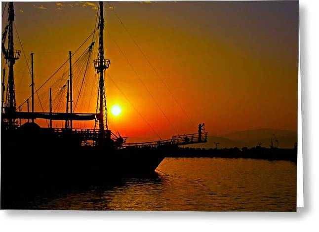 A Digitally Converted Painting Of  A Ship In Silhouette At Sunset Greeting Card