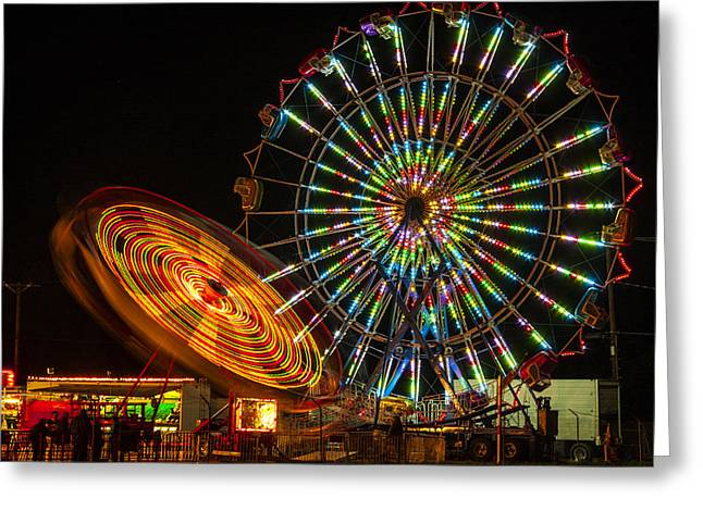 Greeting Card featuring the photograph Colorful Carnival Ferris Wheel Ride At Night by Jerry Cowart