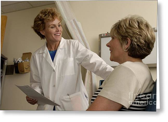 A Female Doctor Talks With A Female Greeting Card by National Institutes of Health
