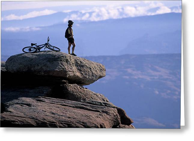 A Female Mountain Biker Stands Greeting Card