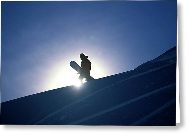 A Female Snowboarder Hiking Greeting Card