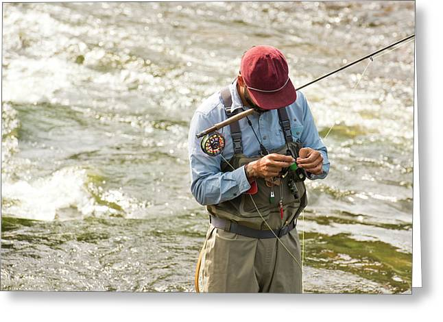 A Fisherman Fixes His Line While Greeting Card