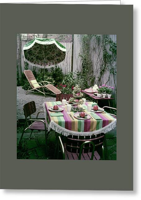 A Garden Set Up For Lunch Greeting Card by Tom Leonard
