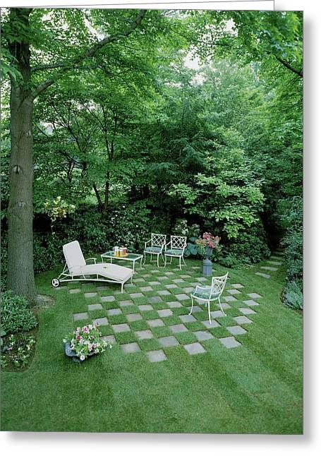 A Garden With Checkered Pavement Greeting Card by Pedro E. Guerrero