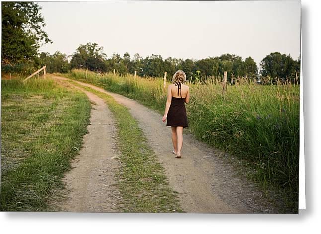 A Girl Wearing A Dress Walks Greeting Card