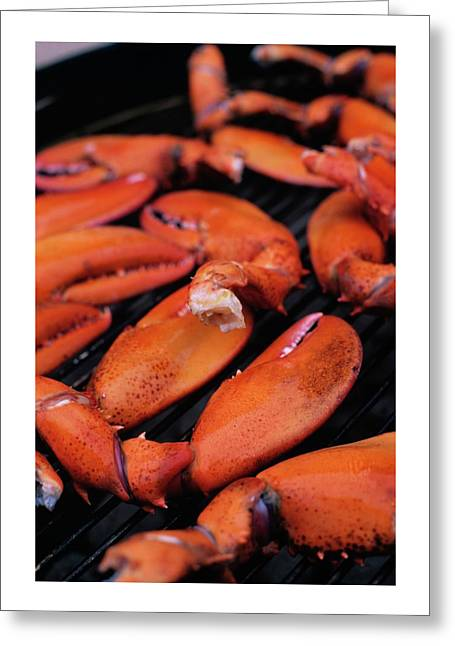 A Group Of Lobster Claws On A Grill Greeting Card