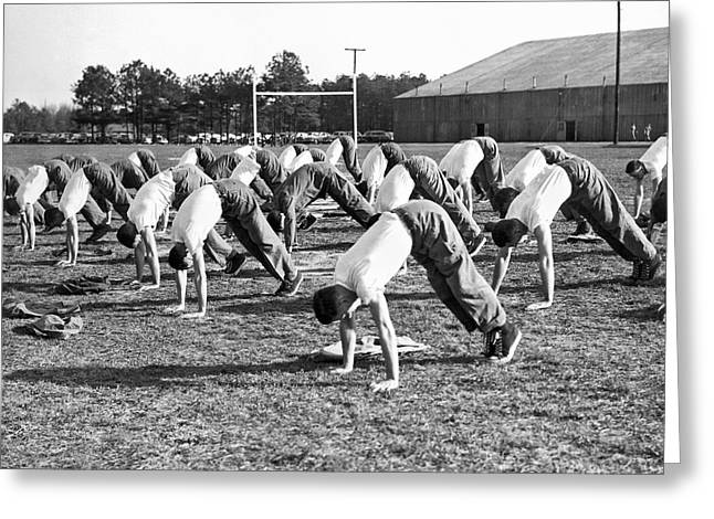 A Group Of Men Doing Calisthetics On An Athletic Field Greeting Card by Underwood Archives