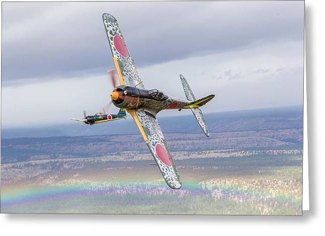A Ki-43 Oscar Breaks Left While The A6m Greeting Card by Rob Edgcumbe
