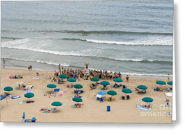 A Lifeguard Gives A Safety Briefing To Beachgoers In Ocean City Maryland Greeting Card