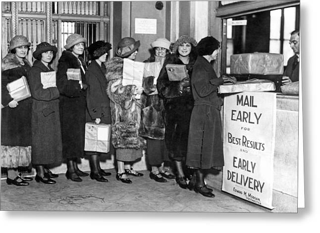 A Line Of Women At The Post Office Mailing Their Christmas Packa Greeting Card by Underwood Archives
