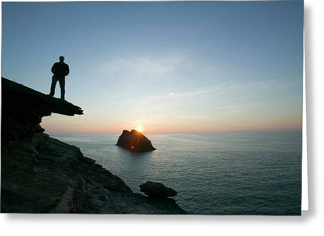 A Man On The Cliff Tops At Boscastle Greeting Card by Ashley Cooper