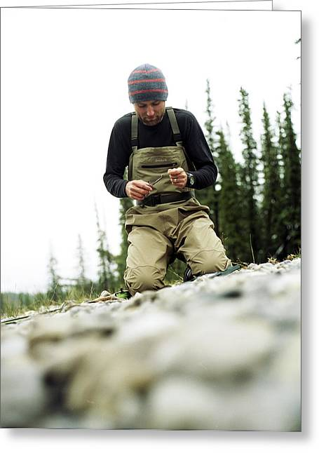 A Man Ties A Fly Beside The Bow River Greeting Card