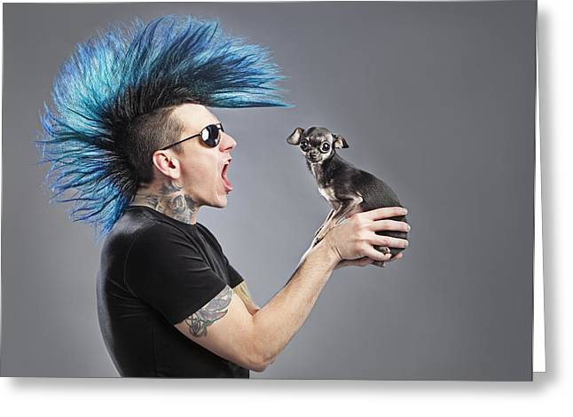 A Man With A Blue Mohawk Yells At His Greeting Card by Leah Hammond
