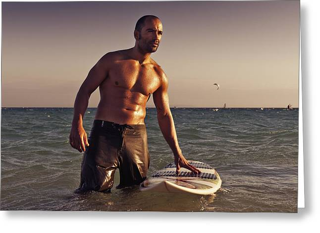 A Man With His Surfboard In The Water Greeting Card by Ben Welsh