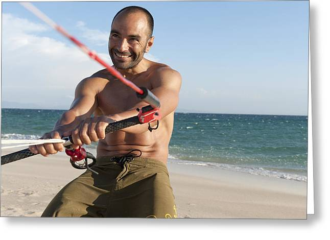 A Man With His Windsurfing Gear On Greeting Card by Ben Welsh