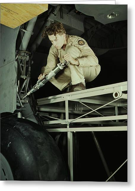 A Mechanic Greasing The Landing Gear Greeting Card by Stocktrek Images